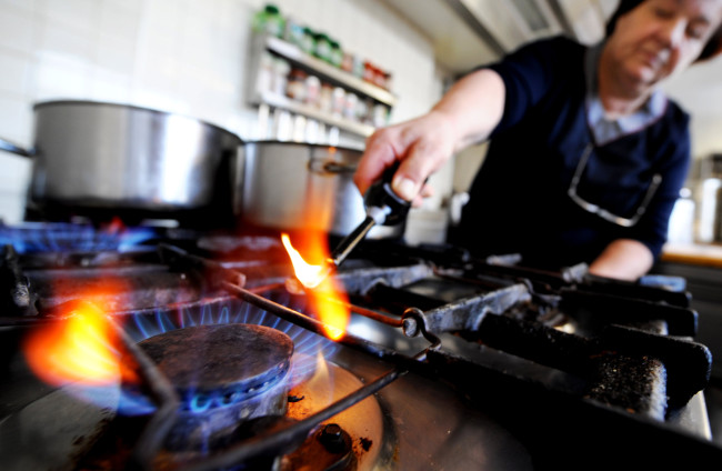 An Austrian hotel owner lights a gas stove to cook for customers in Puch bei Hallein on January 6, 2008. Deliveries of Russian gas to Austria have fallen to 10 percent of the expected amount, Austrian energy company OMV said on January 6, adding that it would have to tap into its reserves. OMV said Gazprom, the Russian state gas monopoly, had initially announced a reduction of 30 to 40 percent but that by 0700 GMT on Tuesday supplies had fallen to 10 percent of the expected amount. Russia cut gas supplies to Ukraine, a key transit point for Europe-bound natural gas, on January 1 as part of a bitter payment dispute.     AFP PHOTO / JOE KLAMAR AUSTRIA-RUSSIA-UKRAINE-EU-ENERGY-GAS AUSTRIA-RUSSIA-UKRAINE-EU-ENERGY-GAS